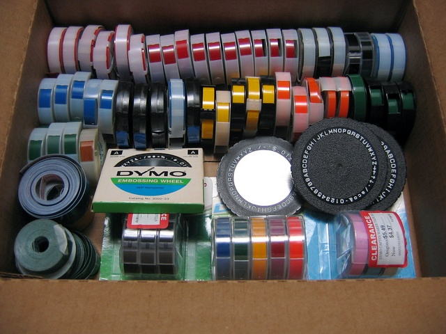 Organized box of DYMO embossing labels