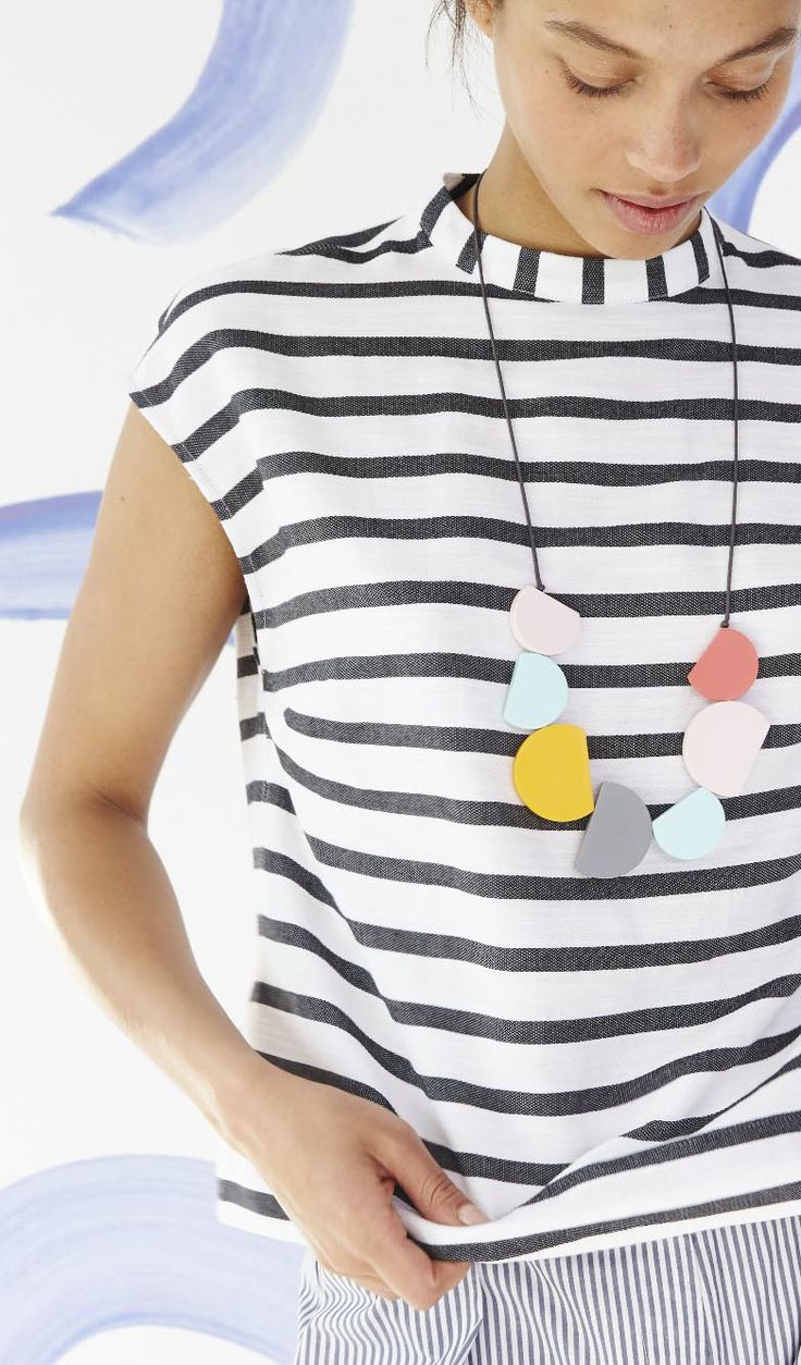 The boxy shape and high neck of this top are balanced out by the nautical stripes and cotton-blend fabric.