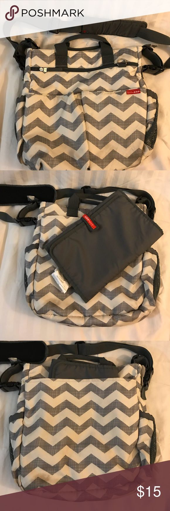 Skip Hop Chevron Diaper Bag Skip Hop Diaper bag in grey chevron print. Comes with changing pad, two drink pockets in either side, Diaper pockets inside and additional side pouches. Some small wear on outside but all shown in pictures! Skip Hop Bags Baby Bags