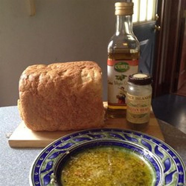 Olive Oil Dip for Italian Bread Recipe Appetizers with olive oil, garlic, balsamic vinegar, parmesan cheese, dried oregano, ground black pepper