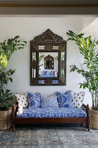Moroccan inspiration: that frame, the indigo patterned linens. Cool! Phoebe Howard - beach house