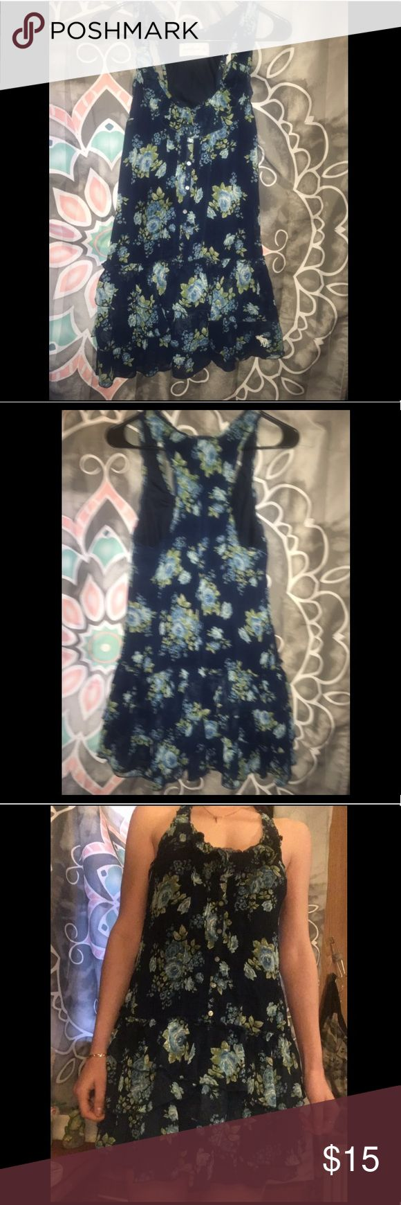 Abercrombie and Fitch Dress I work this one time and it's just been sitting in my closet since. It is designed to look like a skirt and shirt and has a beautiful floral design. Abercrombie & Fitch Dresses Mini