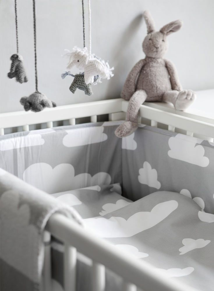 The Only Girl in the House Blog gives great interiors inspiration for grey nursery, gray nursery, baby room, baby bedroom, kids bedroom. grey cot bed bumper with clouds