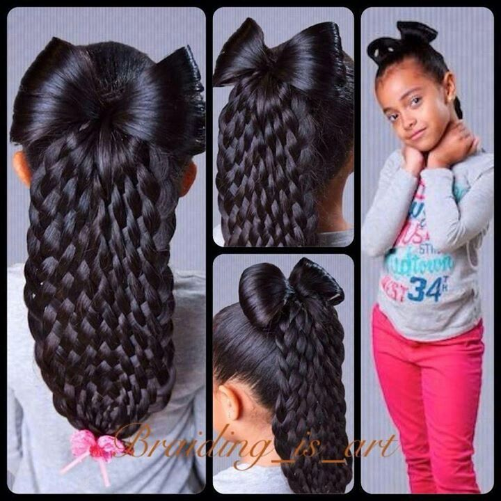 ... is beautiful in a young girls hair. 9- strand basket weave with a bow