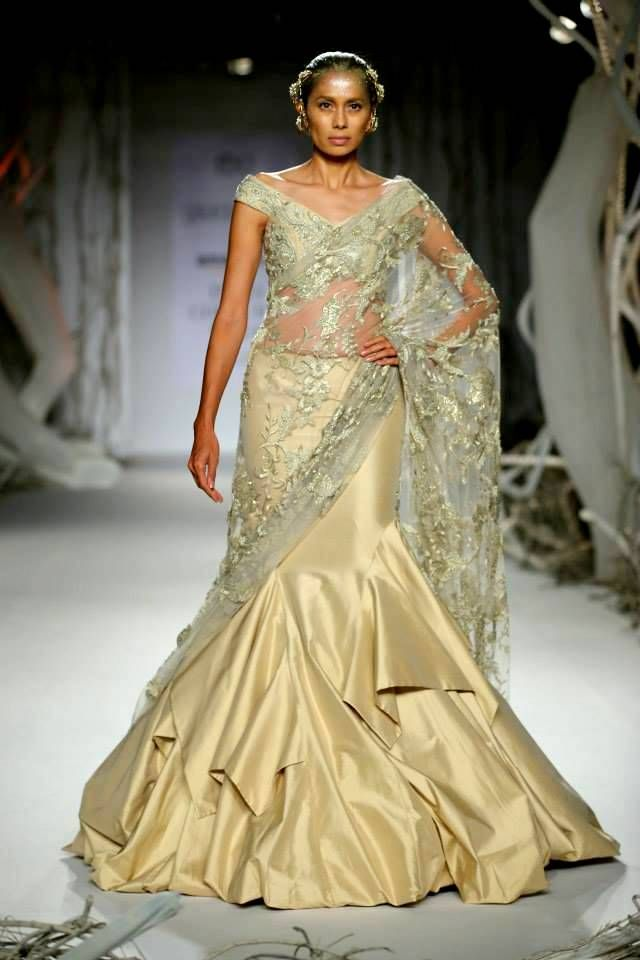This #GauravGupta #gown styled #saree in perfect for a #grand #engagement ceremony