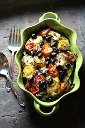 summer vegetable casserole with dry-cured olives.
