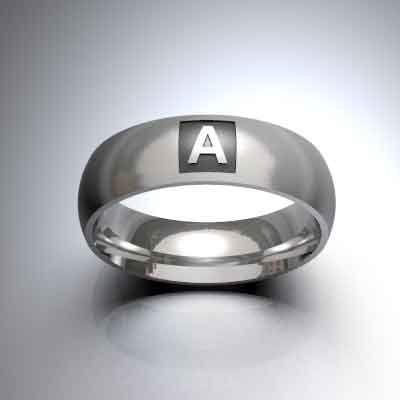 Alianza de boda en plata de 935 mls. acabado mate, personalizada con inicial en color óxido.