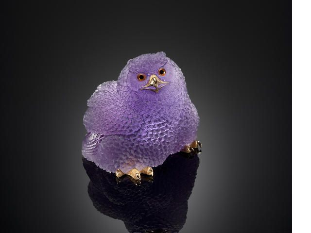Very Fine Amethyst Carving of a Baby Snow Owl By Alfred Zimmerman Idar-Oberstein, Germany  utilizing a pure gem-quality large crystal of Uruguayan amethyst having a high degree of transparency. Mounted with 18K yellow gold feet and beak, with monogram signature AZ for Alfred Zimmerman. Weighing approximately 1360.5 carats and measuring 3 x 2 1/2 x 2in