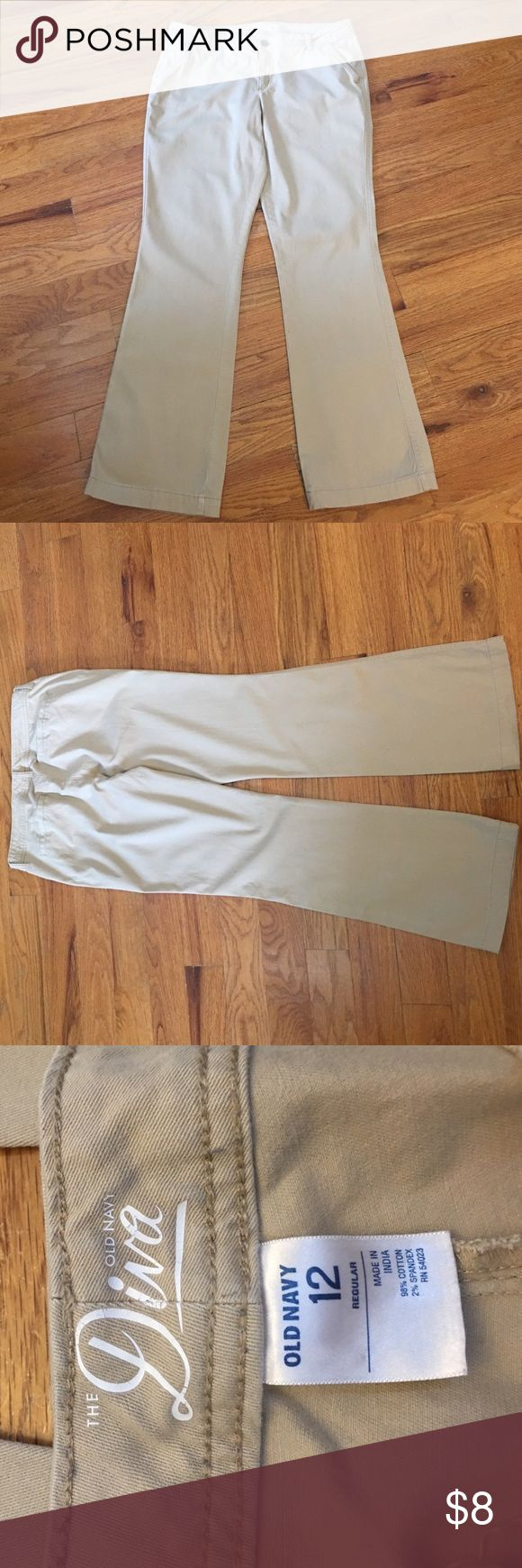 Women's Old Navy Diva Style Khakis size 12 Women's Old Navy Diva Style Khakis size 12, worn a few times. Smoke free home, to tears or holes. No visible stains, the bottoms have a little wear to them but these pants are overall in Good condition. They measure 31 inches from the crotch to the bottoms. Bundle this with 2 other items and receive 20% off :) Happy Purchasing! Old Navy Pants Boot Cut & Flare