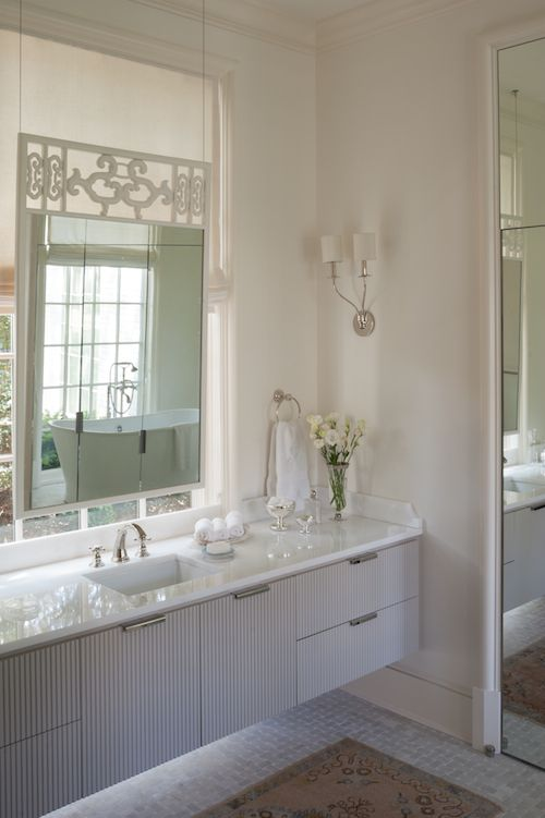 Beautiful Bathroom Features A Gray Floating Washstand Topped With White Marble Hovering Over Basket Weave Tiled Floor Under Vanity Mirror Hanging