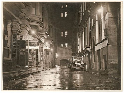 A wet Angel Place, Sydney, 1930s / Sam Hood By State Library of New South Wales collection via Flickr