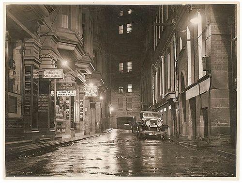 A wet Angel Place, Sydney, 1930s / Sam Hood