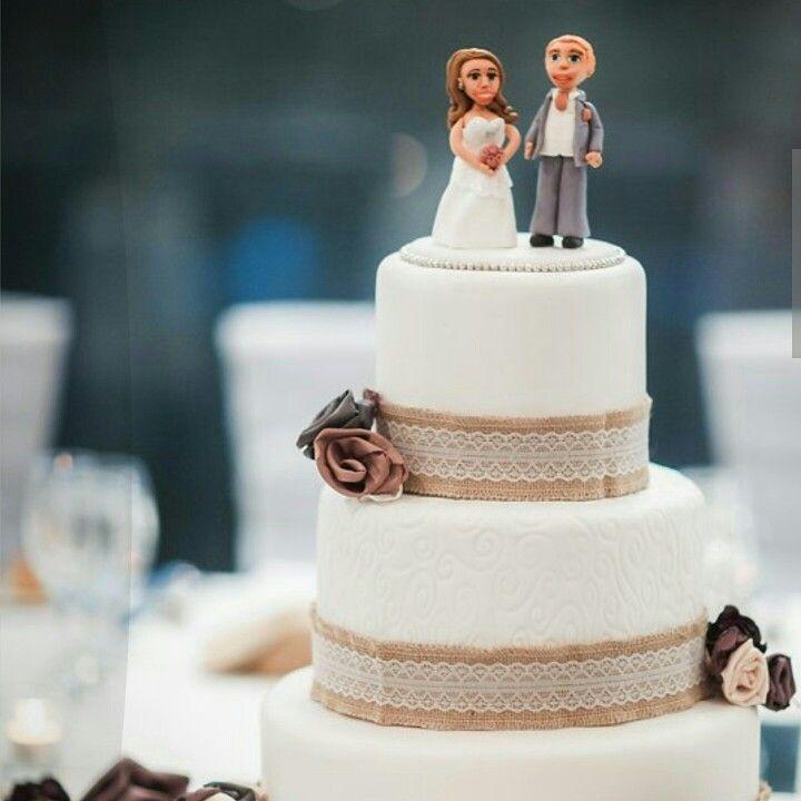 Fondant figurines with burlap and fabric flowers wedding cake