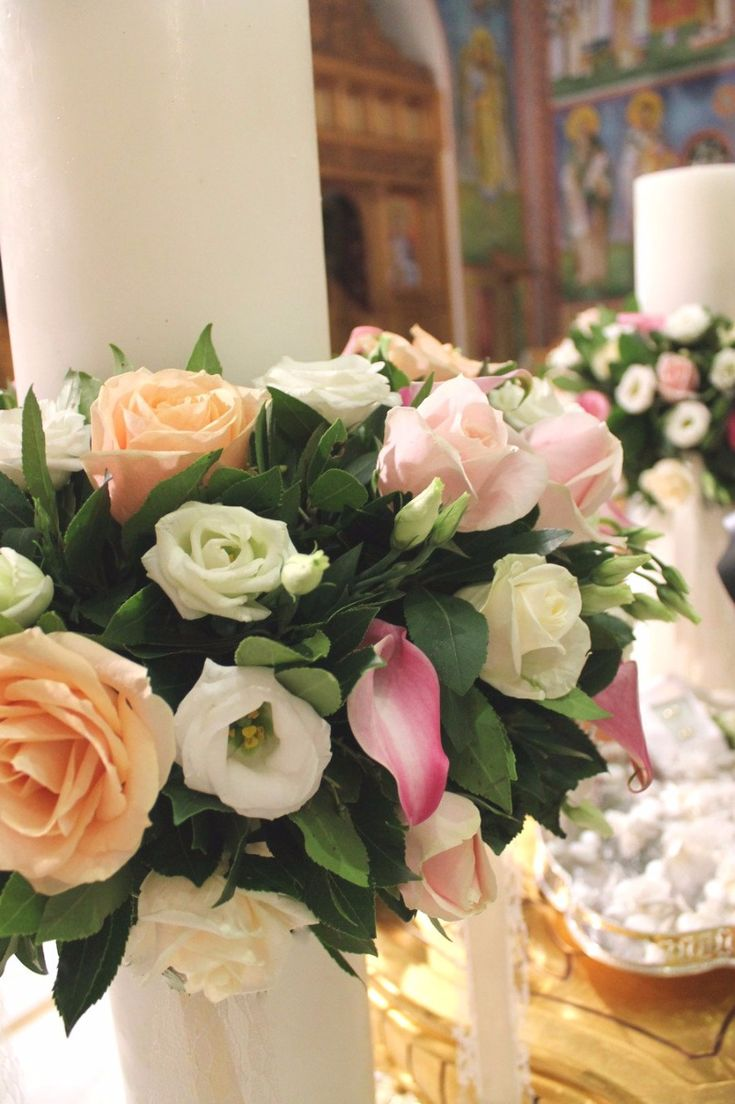 Wedding candles (lambades as they are called in Greek) decorated with fresh flowers. Event Design by Style Concept.