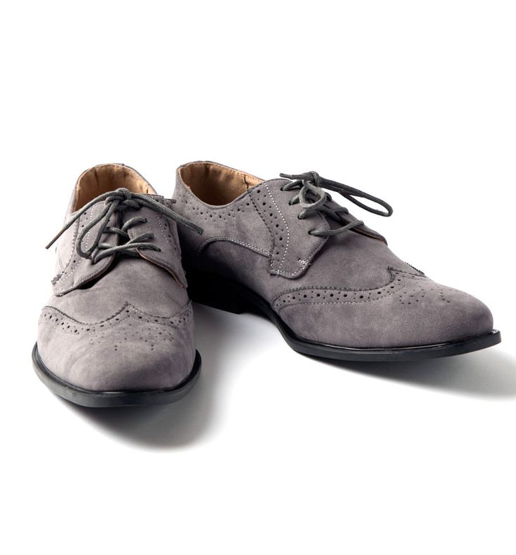Suede wingtips aren't just for preps! These are the kind of shoes that could look just as good dressed up with a tie, or dressed down with a tee. Also perfect for date!!! Man made upper and heel/sole,