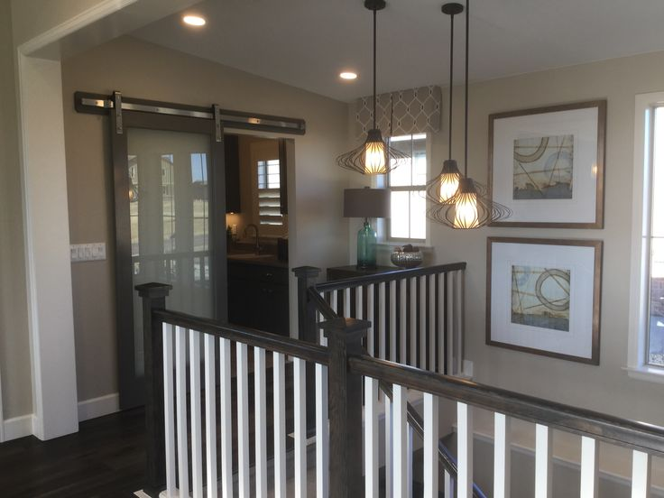Love the barn doors!  Click to take a tour of the Indigo Mist model home by Shea Homes at Backcountry in Highlands Ranch, Colorado.