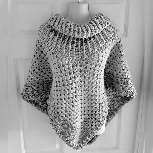 "April's cowl neck poncho ... ""This is my absolute favourite, my 40th! I made using I Love This Yarn in colours Graymist and Cappadocia. It has an ethereal beauty and understated elegance to it,"" she explains"