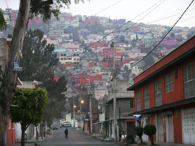 A man walks through a neighborhood of Ecatepec, Mexico,