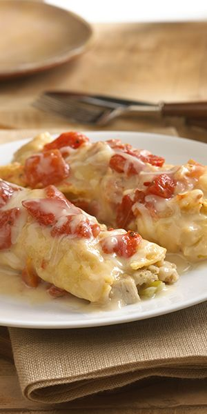 A savory enchilada recipe using leftover turkey, stuffing and cheese wrapped in tortillas topped with gravy, tomatoes and more cheese for a unique way to use holiday leftovers Recipe developed by George Duran for ReadySetEat