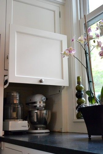 Hinged cabinet for hiding large items- great idea.  Much better then garage door type.  Mk