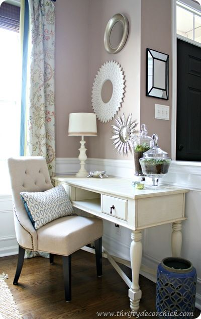 Love this whole corner - from the cream desk to the chair, the items on the wall and terrariums on the desk! via @Thrifty Decor Chick
