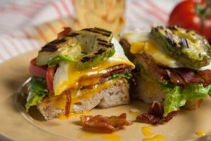 grilled avocado blt fried egg cut plated