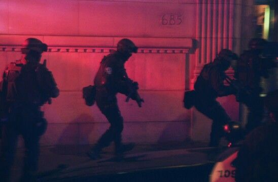 "I peeked around the corner as a line of men in SWAT uniforms poured into the hallway like a stream of ants out of a flooded anthill. ""Drop your guns.""--Clutch"