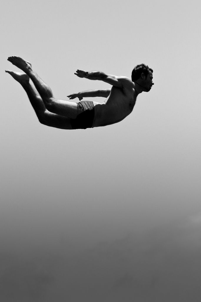 Cliff diving silhouette