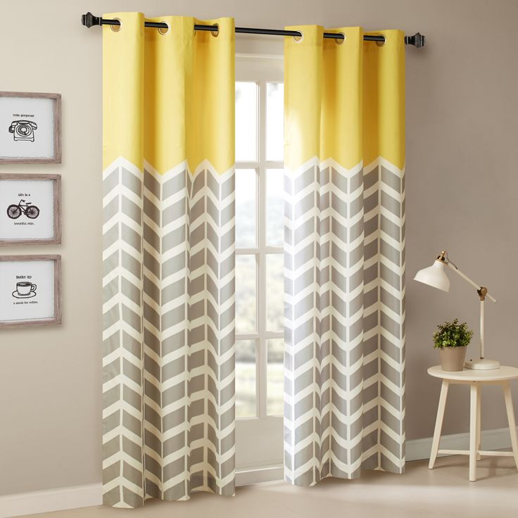 Our Intelligent Design Alex Chevron Printed Panel Pair adds bright color and fun style to your room. These window panels feature a grey and white chevron print and a bold yellow top border, for a refreshingly modern update that pops! Each window curtain is made from a polyester microfiber for easy care, while the foam back finish creates a room darkening effect for energy efficiency. Finished with silver grommet tops making it easier to hang, open, and close panels throughout the day. Fits…
