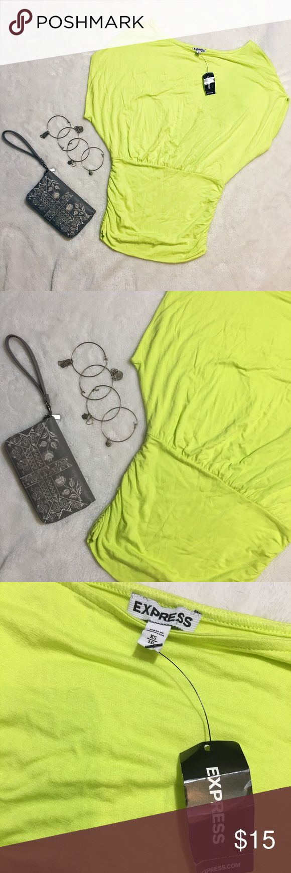 """NWT Express neon yellow top New with tags • Size XSmall • *All measurements are approximate hand measurements taken while garment is laid flat. Double measurement where necessary (i.e. bust)* Bust 21"""" Waist 18"""" Shoulders 12 1/2"""" Length 25"""" Express Tops Blouses"""