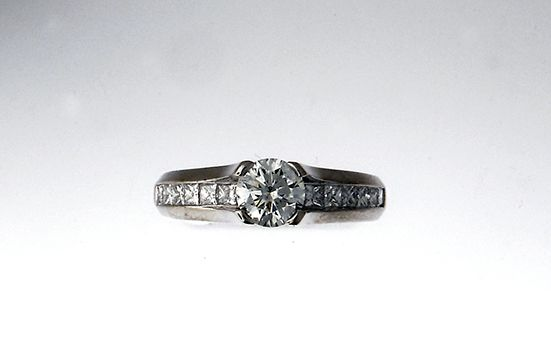 14k white gold engagement ring, with .70ct round brilliant Canadian diamond F/ SI2 ideal cut accented with princess cut side diamonds, (15 .05 G/H VS2-SI1) -SOLD-