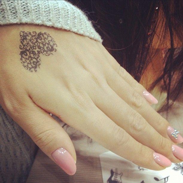 Pretty Heart Hand Tattoo