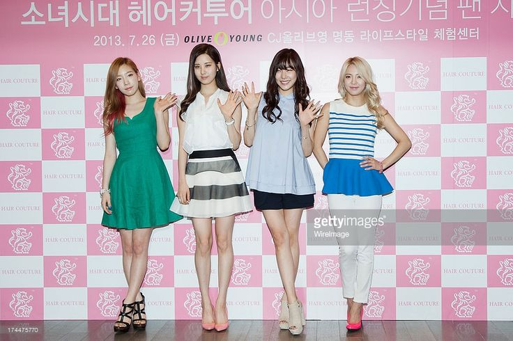 Taeyeon, Seohyun, Tiffany and Hyoyeon of South Korean girl group Girls' Generation attend an autograph session for the 'Hair Couture' at Olive Young Store on July 26, 2013 in Seoul, South Korea.