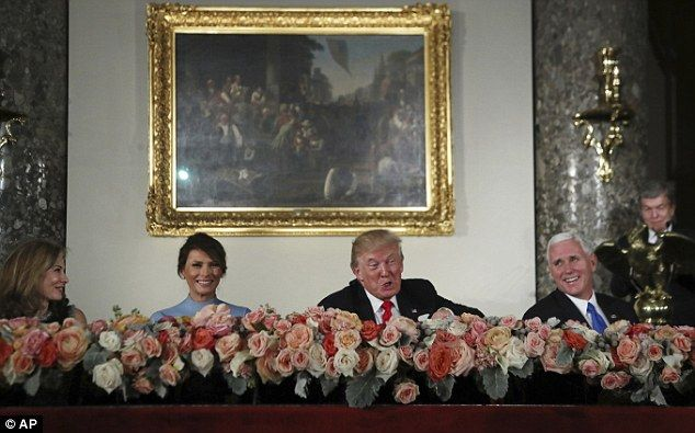 Smell the roses: She sat alongside Trump and Abigail Perlman, the wife of Senator Roy Blun...