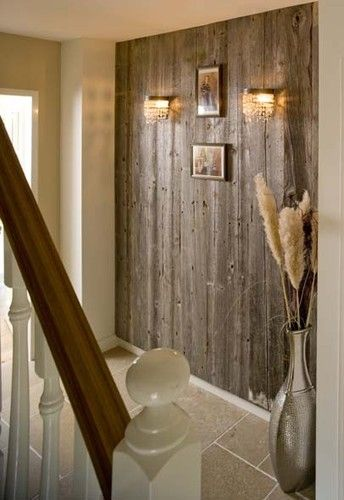 Reclaimed barnwood accent wall. LOVE this.. We need to do this with out wormy chestnut wood!!!
