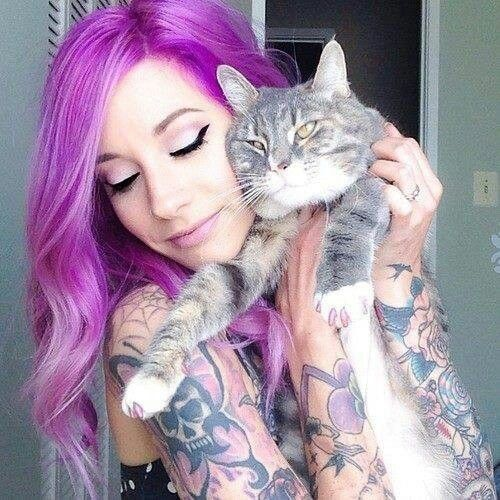 Tattooed girl and her cat.