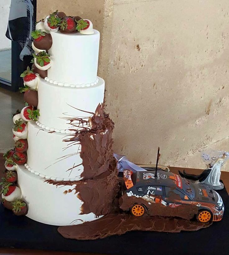 Our wedding cake haha may have to add a jeep beside the race car More