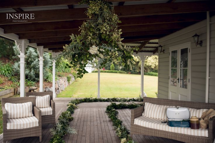 Matt and Elsie's intimate wedding ceremony at the stunning Montville Lake Terrace. We are setting up here installing 23 meters of fresh foliage garland and a handmade floral chandelier (the flowers are not shown in this image). Photograph by Ben from Inspire Photography. Thanks Ben xx