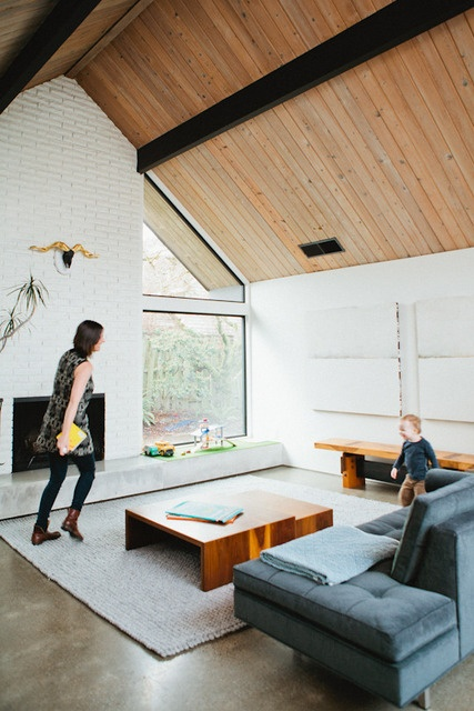 A-Frame - timber ceilings / white painted brick / extended fireplace seat or hearth