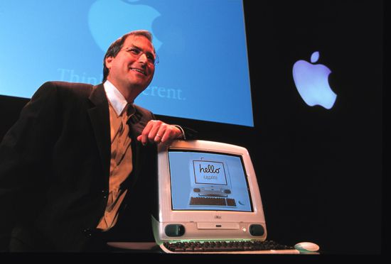 Apple co founder, Steve Jobs, unveils the original iMac all-in-one design in 1998.