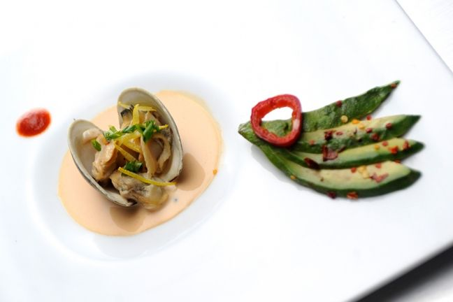 Get the Quickfire recipe for Top Cheftestants Carlos Gaytan and Travis Masar's clams poached in fish sauce with coconut cream here!