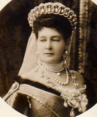 Grand Duchess Vladimir of Russia wearing her tiara c.1900. During the Russian Revolution, this tiara was smuggled out of Russia. In 1921, it was sold by the Grand Duchess's daughter to Queen Mary. She had the tiara altered in 1924 to take 15 of the Cambridge emeralds as an alternative to the original pearls