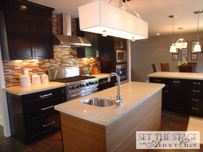 contemporary kitchen with mosaic tile backsplash and commercial stove