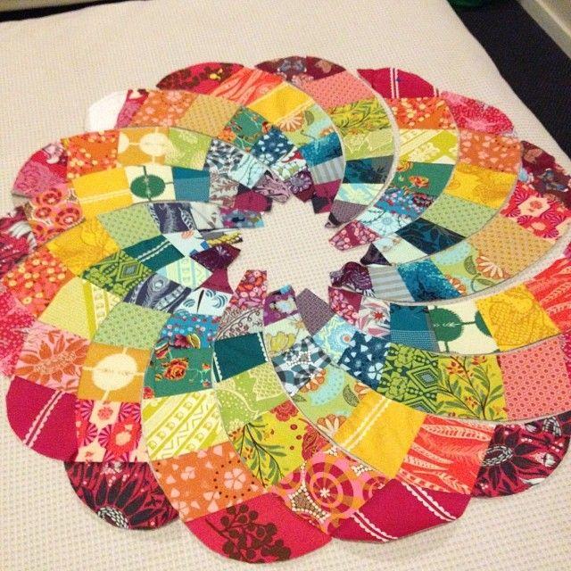 Chris Jurd's Ancient Dahlia pattern in scrappy rainbow of Anna Maria Horner fabrics. From procrasticraft.com