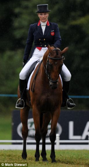 Zara, who won a silver medal in the London 2012 Olympics, was dressed casually for the day in a blue T-shirt and a dark blue gillet. But she...