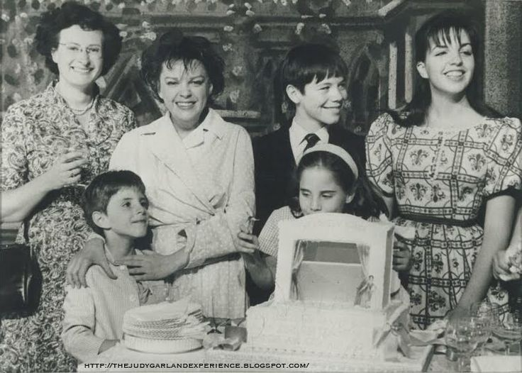 Celebrating Judy's 40th birthday on the set of I Could Go On Singing, June, 1962. From left to right: Lorna Smith, Joe Luft, Judy Garland, Gregory Phillips, Lorna Luft, Liza Minnelli.