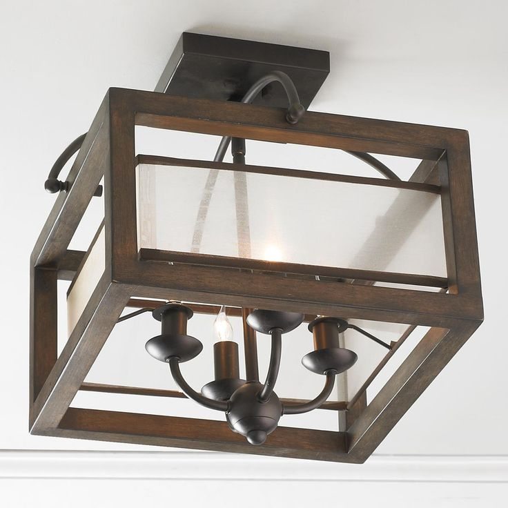 "Square Wood Frame and Sheer Ceiling Light A rustic wood frame with a champagne square shade semi-flush ceiling light has mission rustic style effect for contemporary sophistication. Bronze hardware. (16""Hx16""W)  4 x 60W candle base sockets"