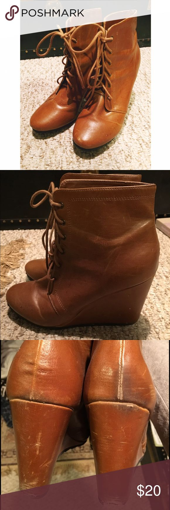 UO Tan Leather Boots Tall wedge boots from Urban Outfitters. Good condition, with some wear on the back (shown in third photo, reflected in price). They have great traction which makes them easy to walk in. True to size. Ask any questions and make an offer! Urban Outfitters Shoes Ankle Boots & Booties