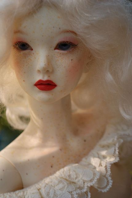 Not my usual style of doll....but her freckles and face are utterly stunning, I have to pin her!