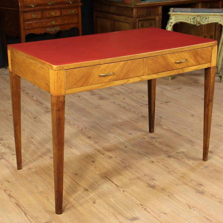 Price: 1200€  Design Italian writing desk in Gio Ponti style. Furniture of the 20th century by the particular design, top made by faux red leather with some signs wear. Desk with two drawers, of great capacity and service, decorated with brass handles. Table desk for interior decorators, designers and collectors. It shows some signs of aging, on the whole in good state of conservation.  #antiques #parino Visit our website www.parino.it